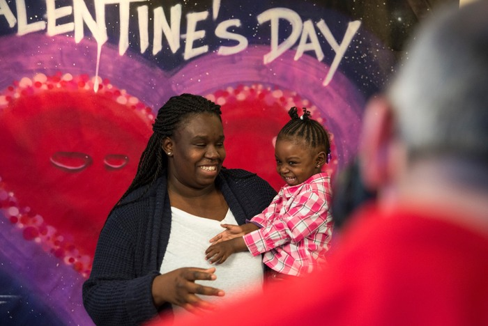 Neighbors pose for a free Valentine's Day portrait