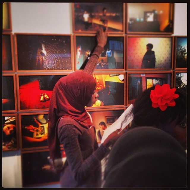 """A student on a scavenger hunt at Gabriele Stabile's """"Refugee Hotel"""" exhibition"""