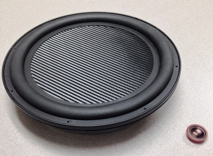 The ThinDriver™ TD-12 Subwoofer next to the AudioCase Mini ThinDriver (Red) showing the scalability of ThinDriver™ Technology. The Mini ThinDriver has 10 times the surface area of a typical smartphone speaker producing, superior audio quality.