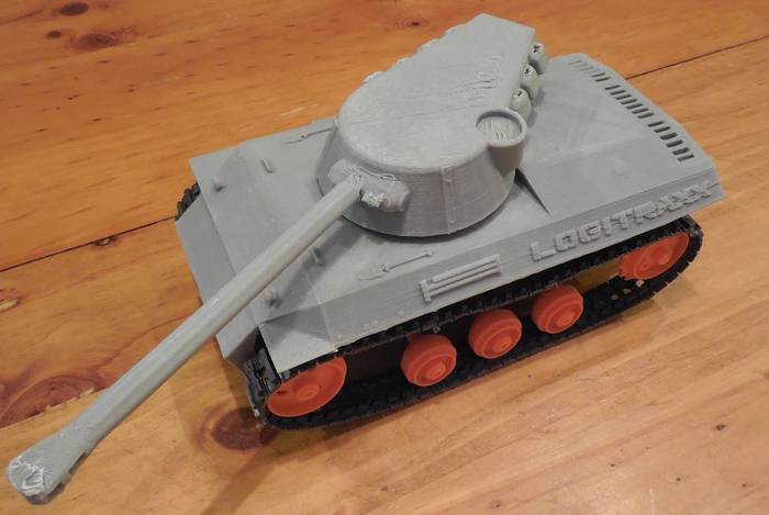 "The 3D printed Logitank bolted to the Logitraxx chassis. Our printer needs a little adjustment. The ""STL"" files for the tank top and other vehicles will be available for download. The turret operates by servo. Download and print your own top."