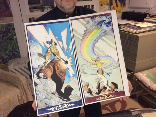 "P. Craig Russell holds his hand-colored original art for ""Donner"" and ""Froh."""