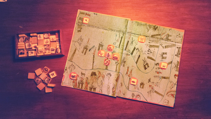 Placing the symbolic blocks on one of the book maps