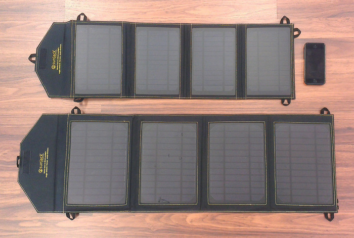 SunJack 14W (top) and 20W (bottom) next to an iPhone 5S
