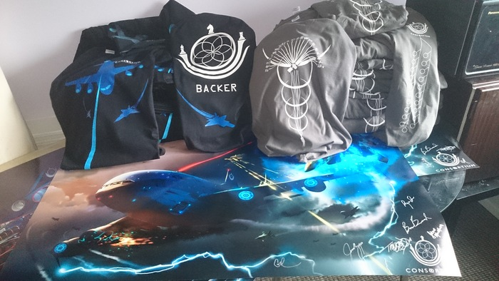 T-shirts and signed poster up close