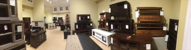 Typical collection of TV stands from a furniture retailer.