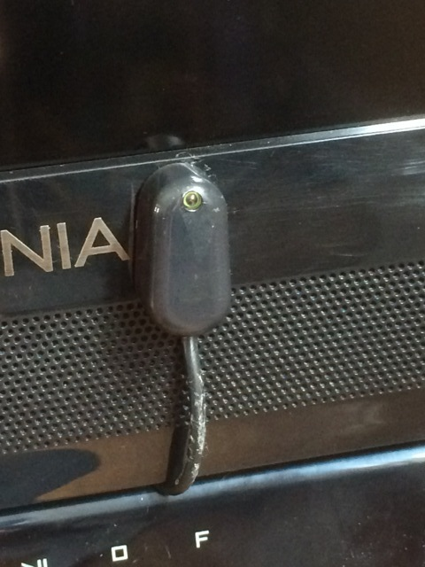 Closeup of remote control repeater that is placed on the TV's front bottom bezel