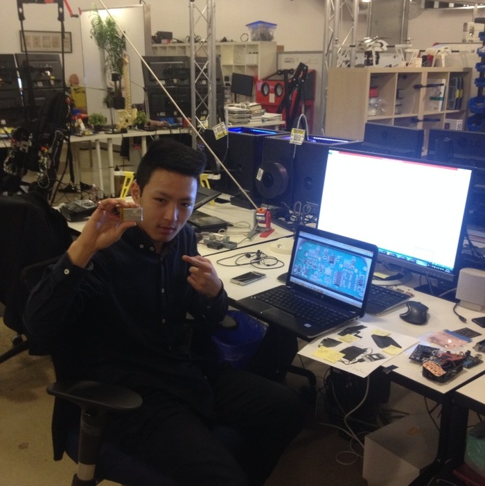 Wei working on a rather primitive Prometheus in the office.