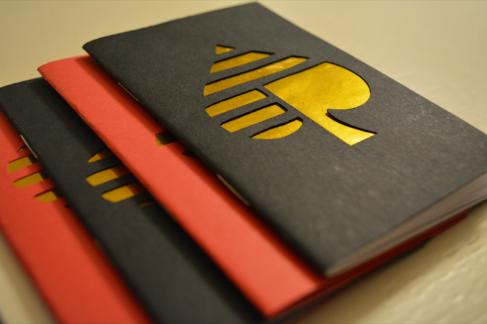 """Deck of Cards notebooks, with the suits cut into the covers. Pocket size for writing down devious schemes on the go. Get the set of four by pledging for the """"DECK + NOTEBOOKS"""" or """"EVERYTHING"""" rewards!"""