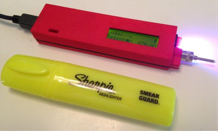 tiq with a highlighter for size comparison