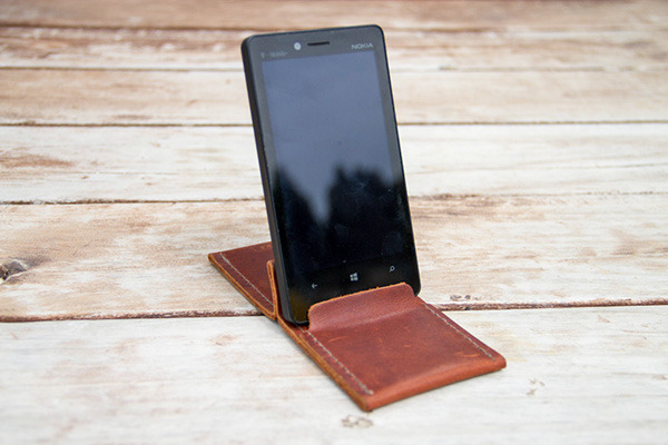 Transforms into a phone stand! Boom. All simple and sleek like.