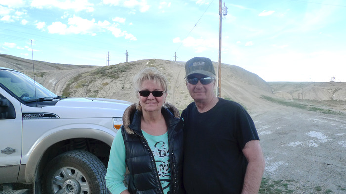 The Uries, Elaine and Steve,  scoping the new driveway