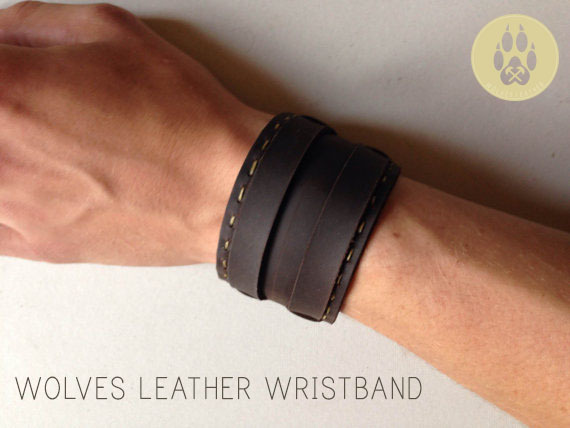 """The Wolves Leather Bracelet is made with today's style in mind. Made with Stone oil leather.  Bracelet is 9"""" by 1 3/4""""  Hand stitched.  If you would like one that will fit you perfectly just send me a message and ill be happy to make it work for you."""