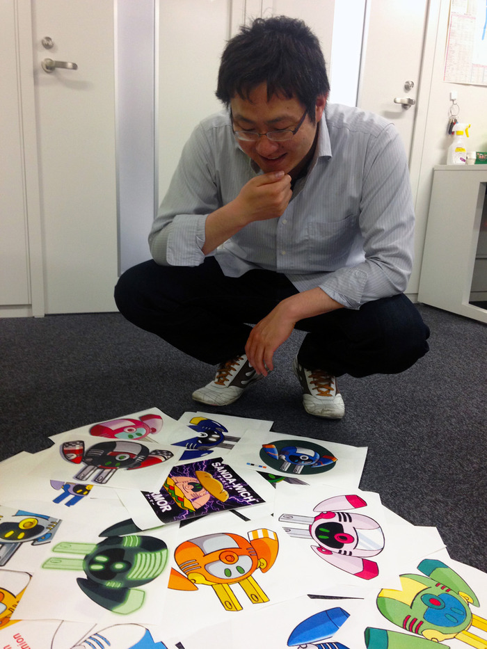 Director Koji Imaeda pouring over your entries...