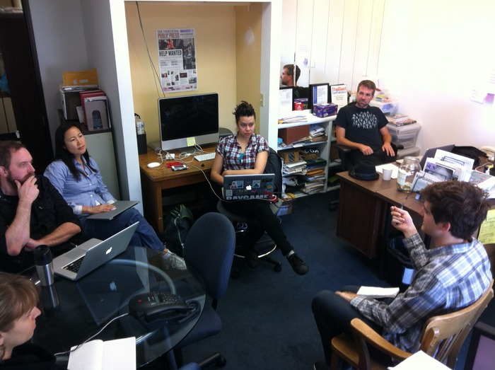 Public Press reporters work collaboratively in our newsroom.