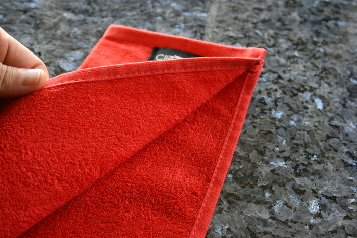Our Patent Pending Clingies™ towel will always hang straight and folded!
