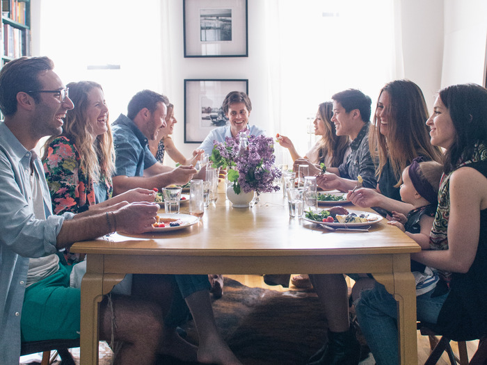 Friends gathered around the yellow table. (Photo by Signe Birck)