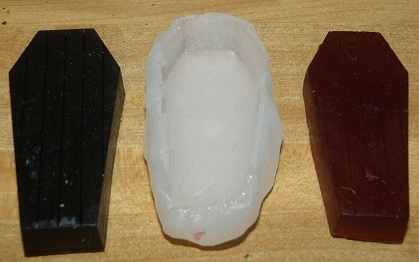 A toy coffin, our homemade mold, and the new soap!