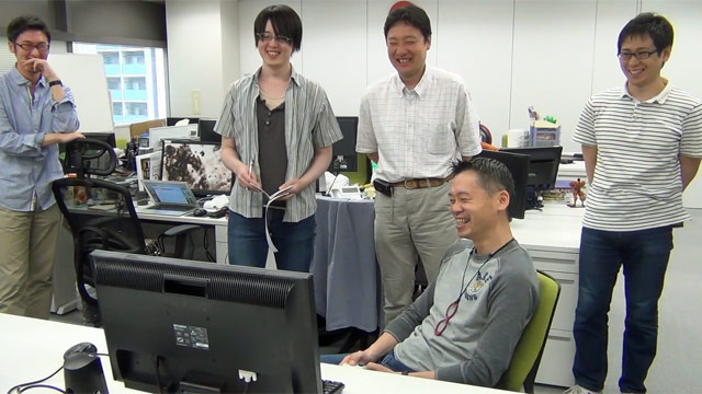 """Don't underestimate my mad skills!"" declares a giddy Inafune to the incredulous yet impressed dev team."