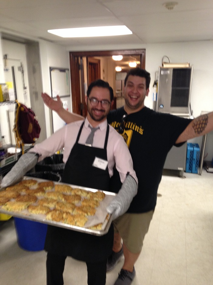 Zahav manager Eilon Gigi volunteering at BSM, with exec chef Steve Seibel and a lot of parmesan-crusted pork loin for their guests.