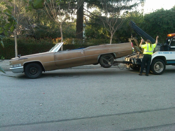 Acquire a well-loved 1969 Cadillac in generally sound mechanical condition.  Convince AAA that you should get free towing to retrieve it.