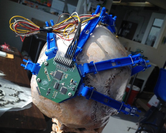 """An OpenBCI working prototype (a.k.a. """"Frankenboard"""") mounted on Spiderclaw"""