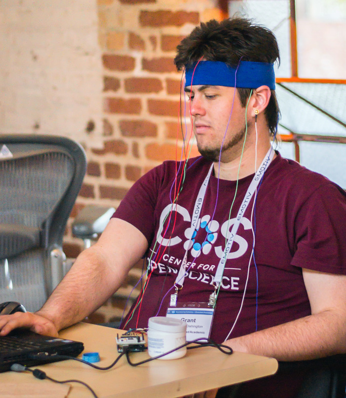 UC San Diego graduate research fellow Grant R. Vousden-Dishington rocking out with an early OpenBCI prototype at the Neurogaming Brainihack hackathon