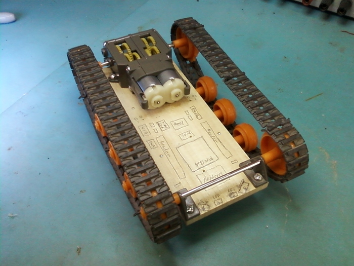 Wooden chassis with circuitry drawn on top