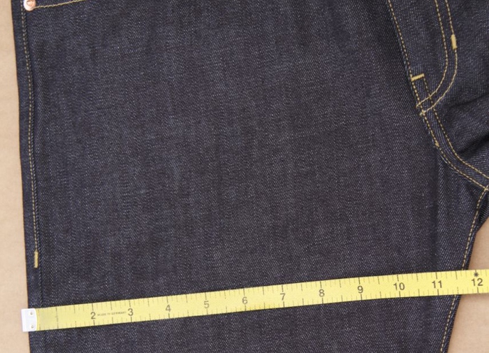 """THIGH: This measurement was taken from our mens size 34. Measurement is 2"""" down from the crouch seam. You will multiply this number by two. The thigh on this jean is 23.5""""."""