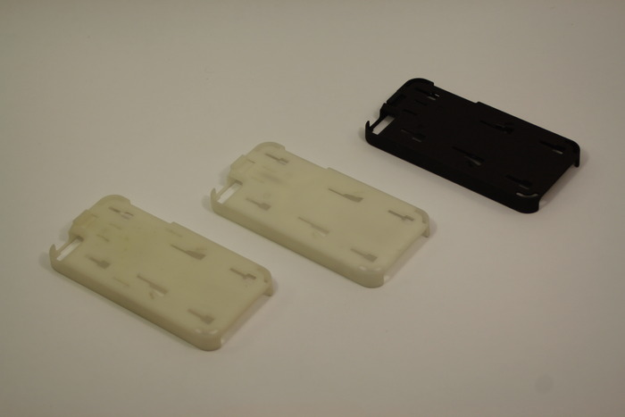 Two iterations of SLA prototyping and one 3D-printed test
