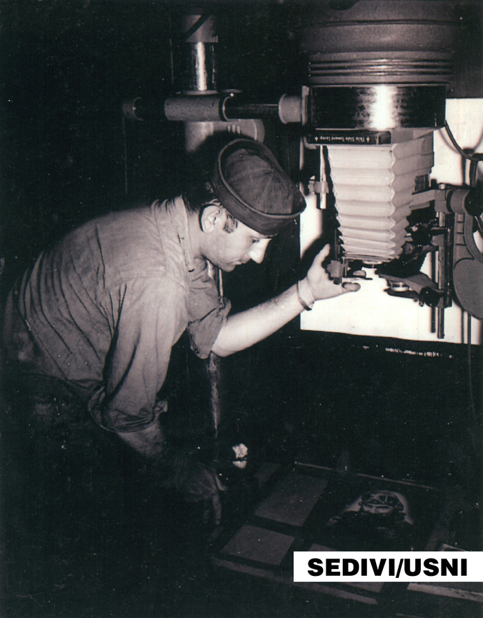 A J Sedivi in the photo lab on the USS Indianapolis