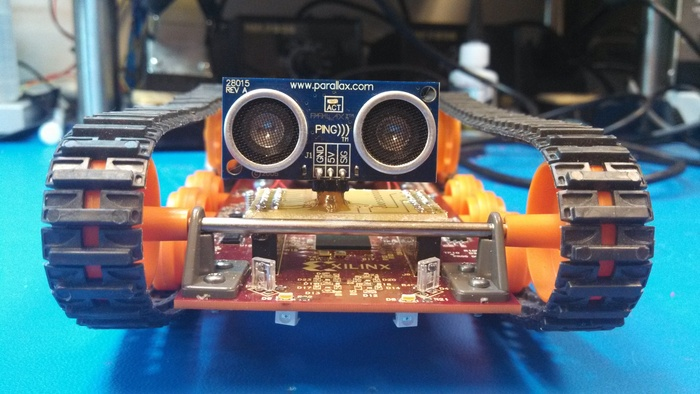 Logitrax equipped with Parallax Sonic Sensor for distance measurement and IR sensors for avoidance.  Notice the IR Emitters underneath.