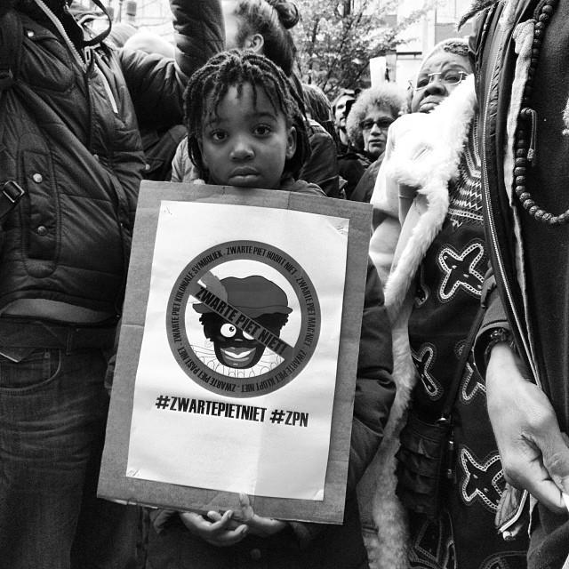 Child Activist at Zwarte Piet Niet Demonstration, Amsterdam, NL ca. 2013 | Photo Credit: Shantrelle P. Lewis