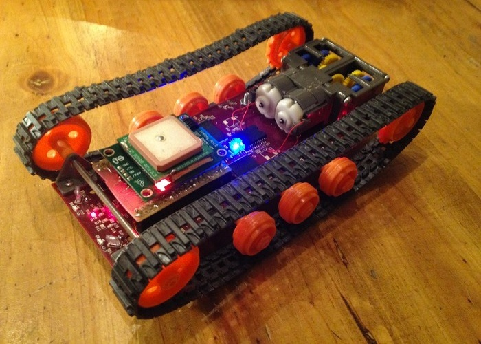 """Though not part of the kit, this picture shows a Parallax GPS Receiver mated to GPIO using a rough hand made shield. The red LED is solid """"on"""" indicating position lock. Logitraxx knows where it is on planet Earth."""