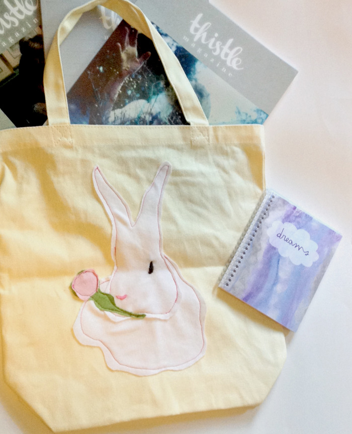 Prize Bundle including tote bag, dream journal, and magazines.