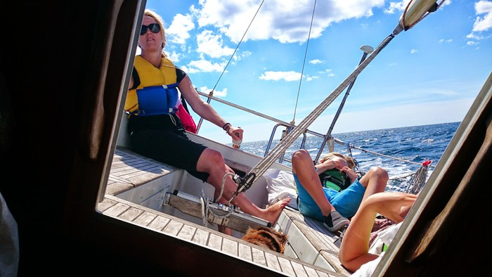 Sailing in Sweden, with wife and kids. My wife Mette at the helm