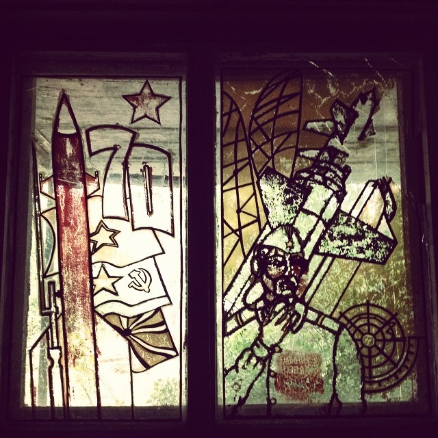 This stained glass window was on the outside of some kind of sports/entertainment house.