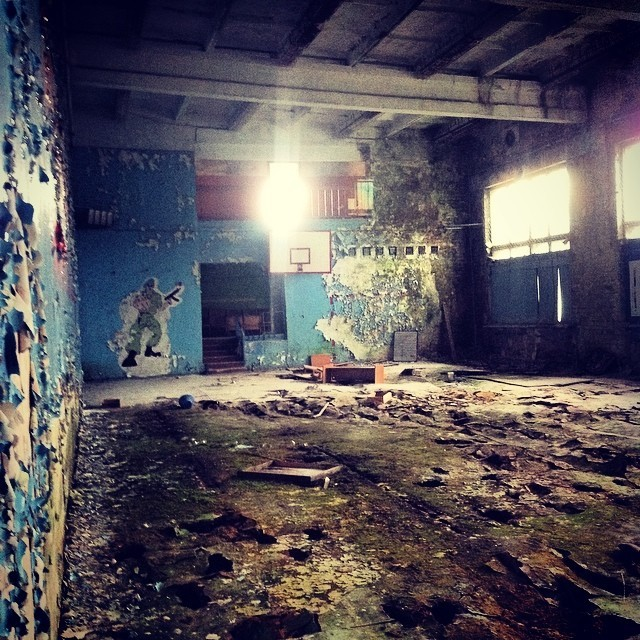 Here's what's left of their basketball court. This is the second basketball court I've found in an abandoned Soviet era building.