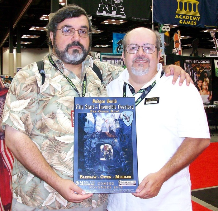 James Mishler and Bob Bledsaw II holding the CSIO Pre-order Poster