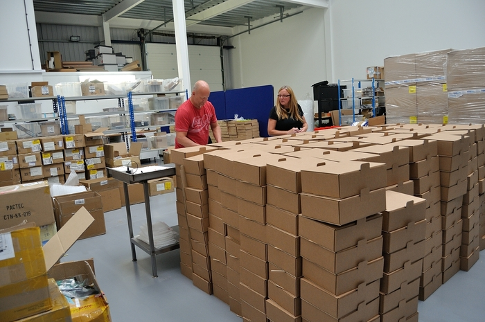 Loads of boxes. Shipping boxes foreground, goods boxes background