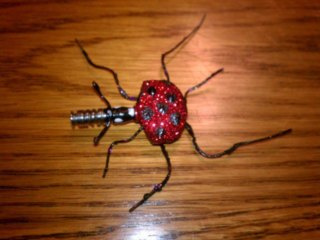 $30- Ladybug from a guitar tuner key!