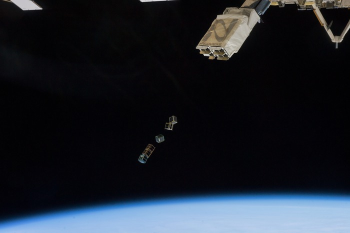 "SkyCube deployment from ISS, 28 Feb 2014.  SkyCube is the middle satellite in the ""train."""