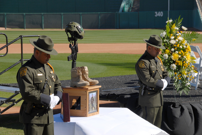 An honor guard stood watch over the boots, rifle and helmet of slain Border Patrol Agent Brian Terry at a 2011 memorial service. Photo by Dylan Smith/TucsonSentinel.com