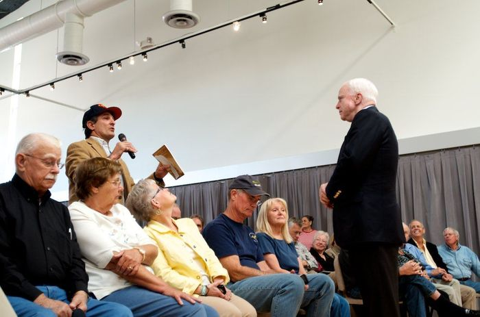 Jeff Zeidman, a resident of Green Valley, holds up a copy of the Constitution to highlight his point about the failure of the federal government during a town hall with U.S. Sen. John McCain in 2013. Photo by Paul Ingram/TucsonSentinel.com