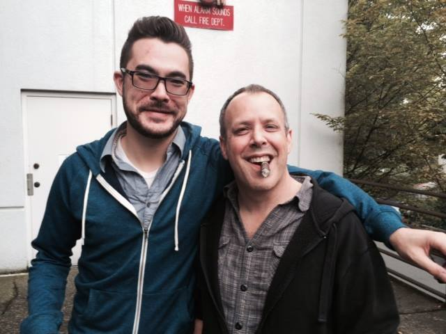 Mitch and I celebrating launch day with obligatory whiskey & cigars!