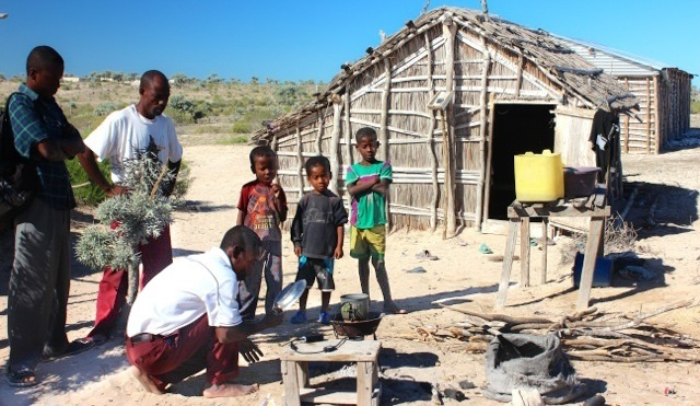 Our friend using his new PowerPot to charge up the cellphones of his fellow villagers (Tulear, Madagascar).
