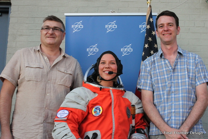 Brienna Henwood, Dir. of Space Training & Research at NASTAR, demonstrates her hero pose at FFD's unveiling of the Space Suit Experience.