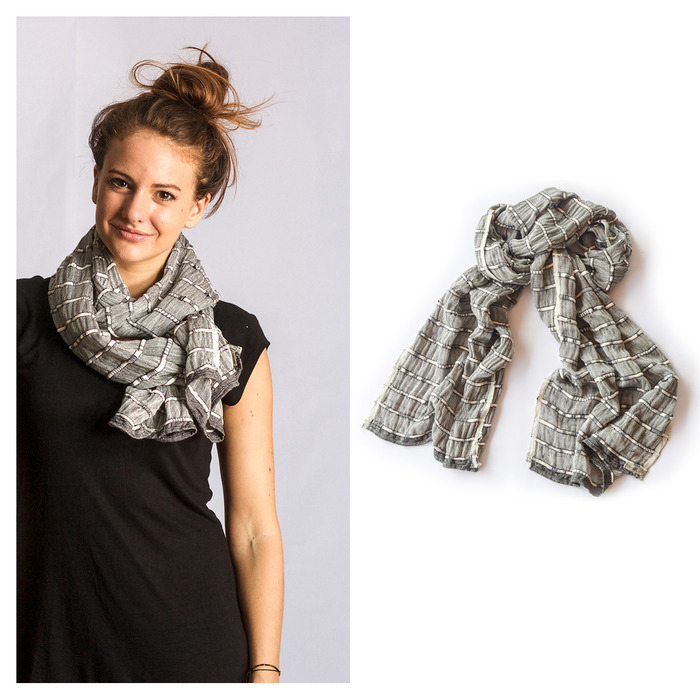 The Takeo Scarf, a tonlé design handwoven by the Cambodian Weaving Village. This piece mixes remnant cotton threads with the tiniest scraps of waste fabric from our production