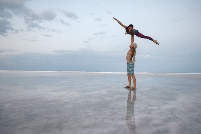Maintaining their life, work and romantic relationship on the road has been a series of balancing acts!  Photography by Eric Ward.