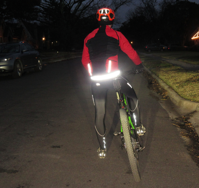 Flash photography with car lights shining on the reflective strip illustrates the terrific visibility of the Mighty Click wearable bike lock in the dark and at dusk.