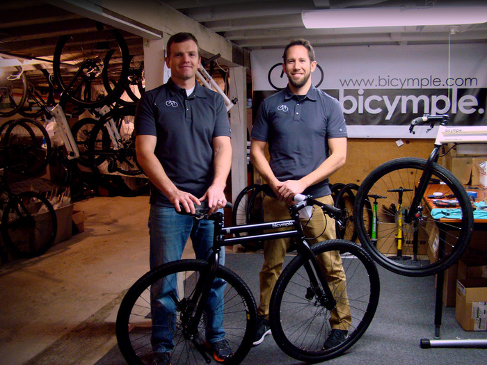Gabe & Josh, with one of the (mostly) assembled Kickstarter bicymples.